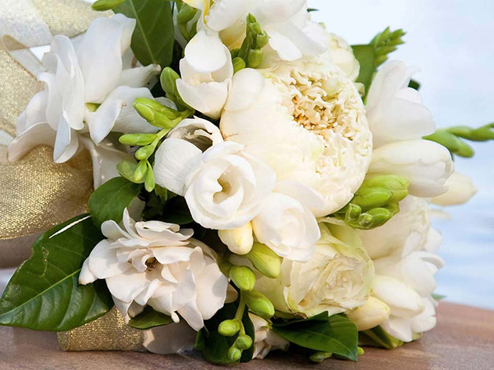 White wedding flowers on a dock